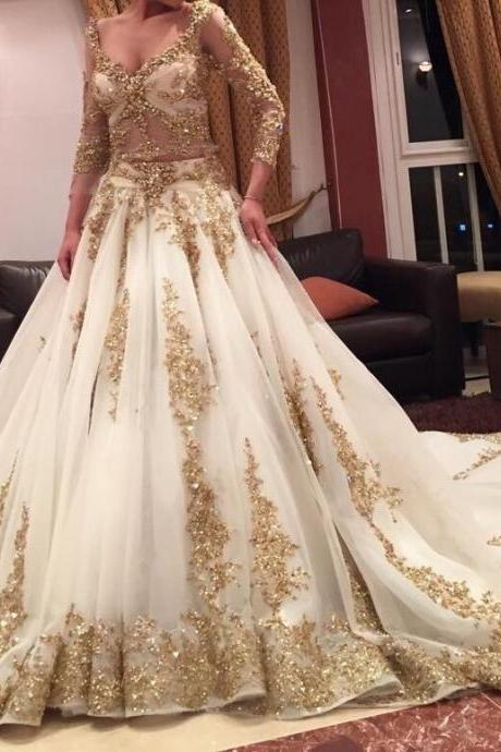 Gold Lace Appliqués Plunge V Long Sleeves Floor Length Wedding Gown Featuring Train