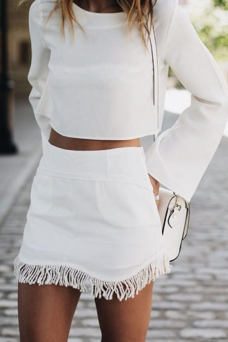 White Two-Piece Set Featuring Long Flare-Sleeved Cropped Top and Short A-Line Skirt with Tassel Hem